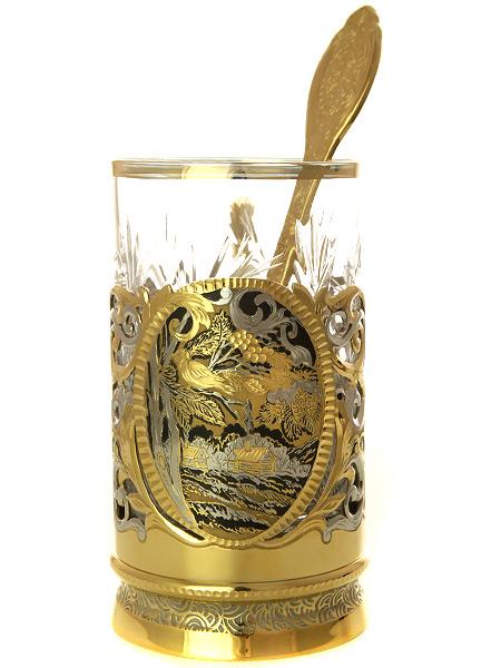 Позолоченный подстаканник чайный Снегири с ложкой, хрустальным стаканом в подарочном футляре ЗлатоустЧайный набор позолоченный. &#13;<br>Состоит из подстаканника, стакана, ложки.&#13;<br>Упакован в подарочную коробку.&#13;<br>Ручная работа.<br>